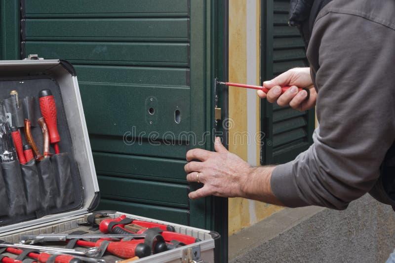 Locksmith repair the door lock royalty free stock photo