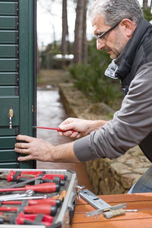 Locksmith repair the door lock royalty free stock image