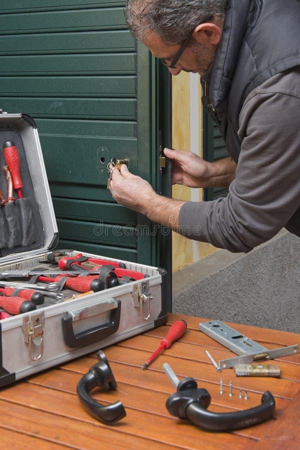 Locksmith repair the door lock stock images