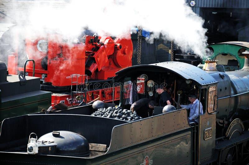 Locomotive crew reversing steam train. stock photos