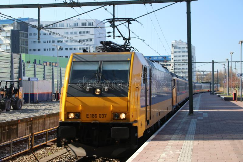 Locomotive of the Intercity Direct by Bombardier arriving along platform of Rotterdam Central station in the Netherlands. stock photo