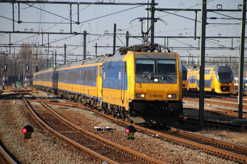 Locomotive of the Intercity Direct by Bombardier arriving along platform of Rotterdam Central station in the Netherlands. stock photography
