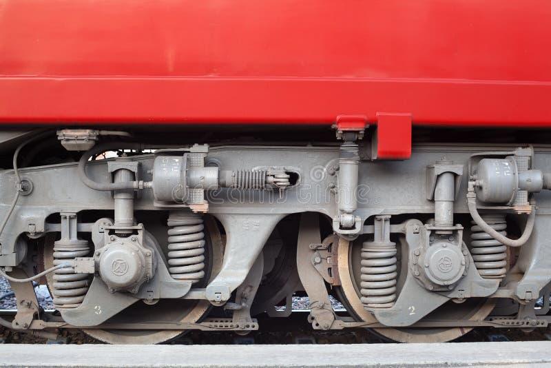 Locomotive on railway station, iron train wheels mechanism close up, steel rail wheel construction, railroad wagon part stock photography
