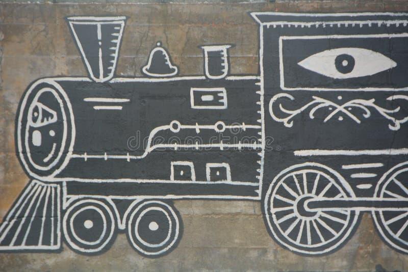 Locomotive engine graffiti in SE Portland, Oregon. This is locomotive train engine graffiti decorating a building wall in SE Portland, Oregon`s industrial area stock photos