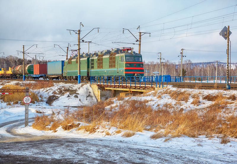 Locomotive on Trans-Siberian Railway. In winter Siberia royalty free stock photography