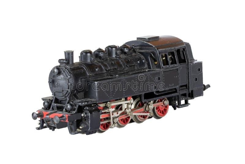 Locomotora aislada Modelo del vintage de un tren eléctrico del vapor del juguete aislado en un fondo blanco Fondo de las decoraci fotografía de archivo