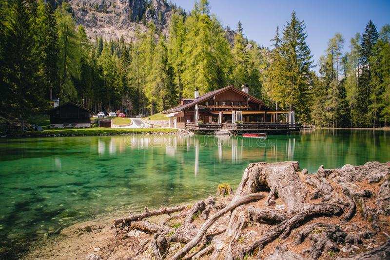 The lodge over the turquoise waters of Lago Ghedina, an alpine lake in Cortina D`Ampezzo, Dolomites, Italy stock images