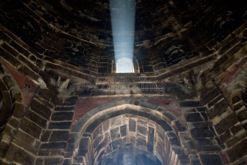 Lodhi Garden Tomb with light beam. New Delhi India. Lodhi Garden Tomb with light beam. Delhi India. Light streams through the haze stock photos