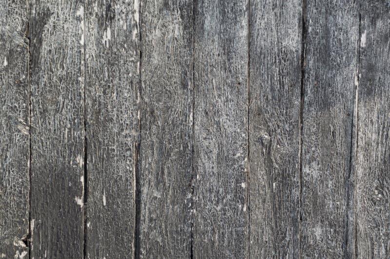 Lodlinje riden ut målad svart träbrädebakgrund arkivfoton