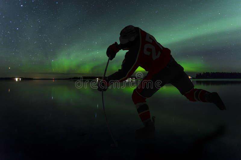 Lodowego hokeja Północni światła zdjęcia royalty free