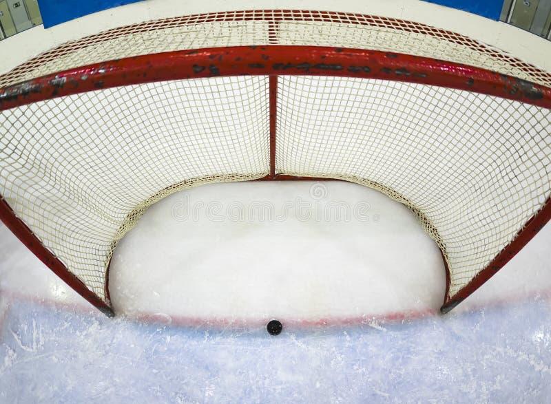 lodowy hokej, hokejowy krążek hokojowy fotografia royalty free