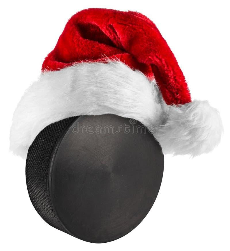 Lodowy hokejowego krążka hokojowego Santa kapelusz obraz royalty free