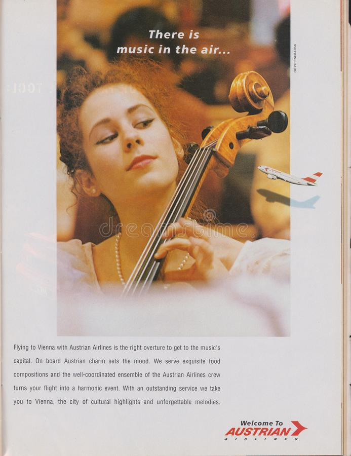 Poster advertising Austrian Airlines in magazine from 1992, There is music in the air slogan stock photo