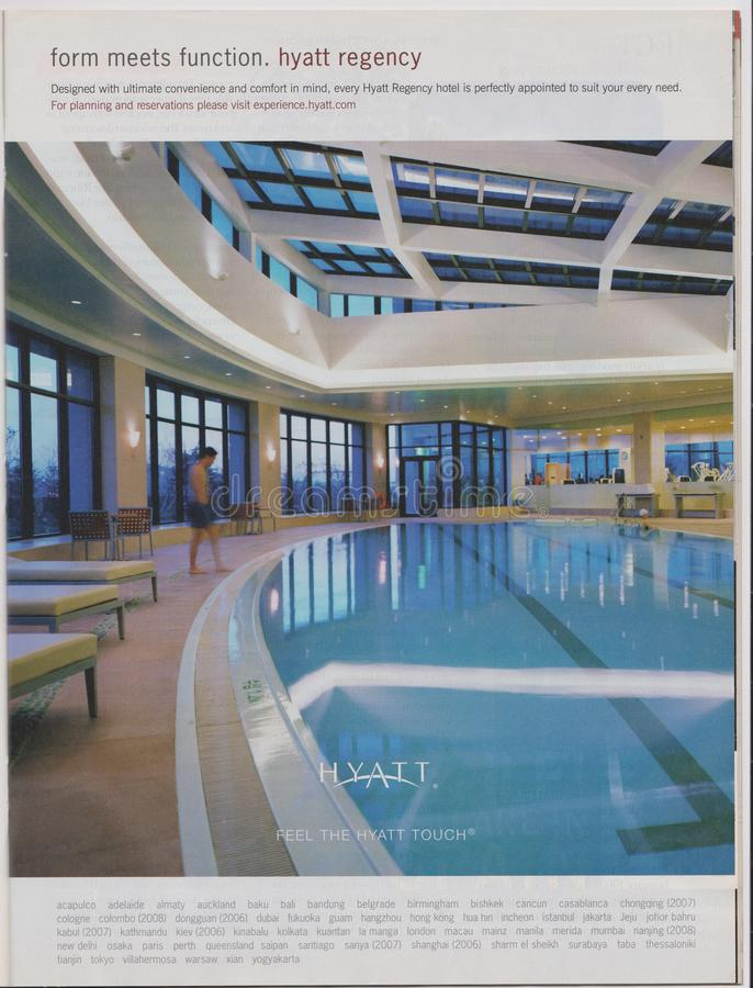 Poster advertising Hyatt Hotel in magazine from October 2005, form meets function. Feel the Hyatt touch slogan royalty free stock photography