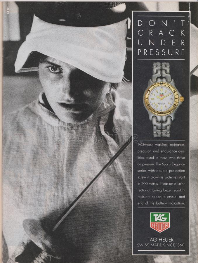 Poster advertising TAG-Heuer watch in magazine from 1992, DON`T CRACK UNDER PRESSUERE slogan stock photos
