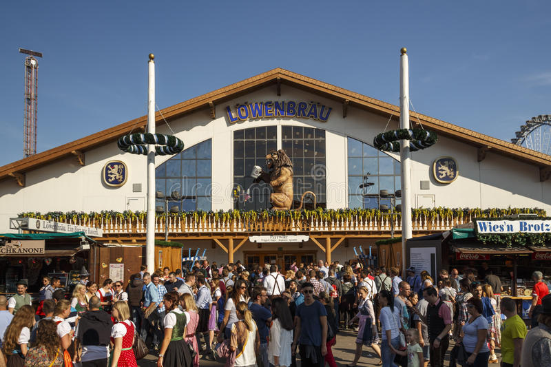 Loewenbraeu tent at Oktoberfest in Munich, Germany, 2016. Munich, Germany - September 24, 2016: Facade and entrance of the Loewenbraeu beer tent with people stock images