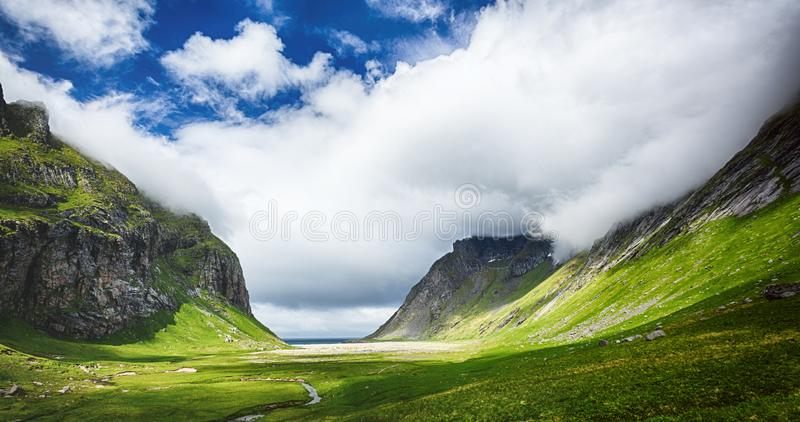 Lofoten Islands, Horseid Beach by Summer. Scenic landscape view of the valley leading to the beach stock photo