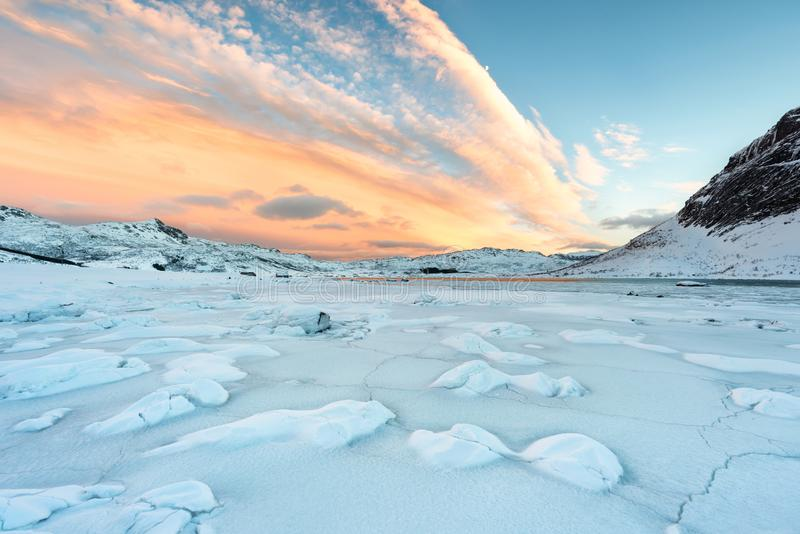 Lofoten Islands in Norway and their beautiful winter scenery at sunset. Idyllic landscape with snow covered beach. Tourist attract. Ion in the arctic circle stock images
