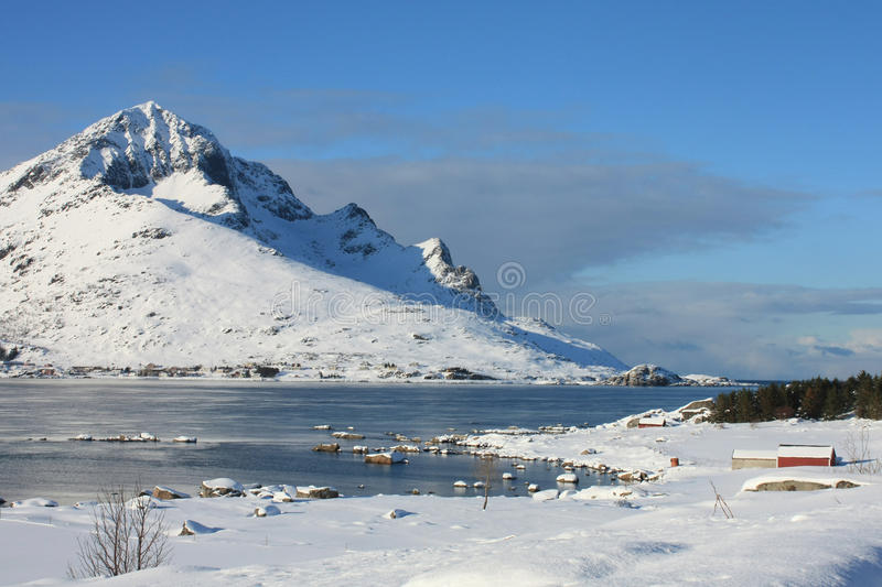 Lofoten mountains and fjords II. The small village of Sund in a fjord surrounded by the mountains royalty free stock image