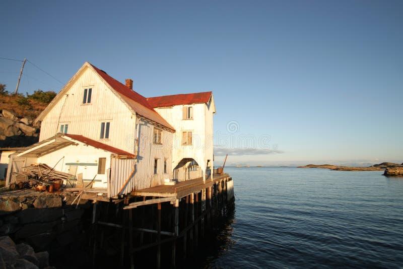 Lofoten's abandoned fish factory at sunset stock images