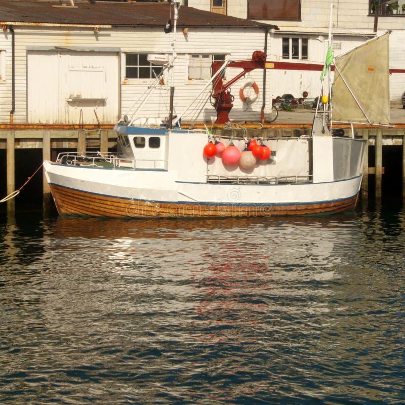 Lofoten's fishing boat. Cod's fishing boat in Henningsvaer i Lofoten harbour, Norwegiaarctic ocean stock image