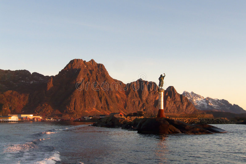 Lofoten's harbour. The entrance of Svolvaer's harbour, Lofoten islands and the statue of the fisherman's wife royalty free stock images