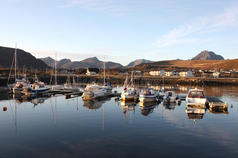 Lofoten's harbour and mountains. The small harbour of Gravdal, Lofoten islands, in a fjord surrounded by mountains royalty free stock photos
