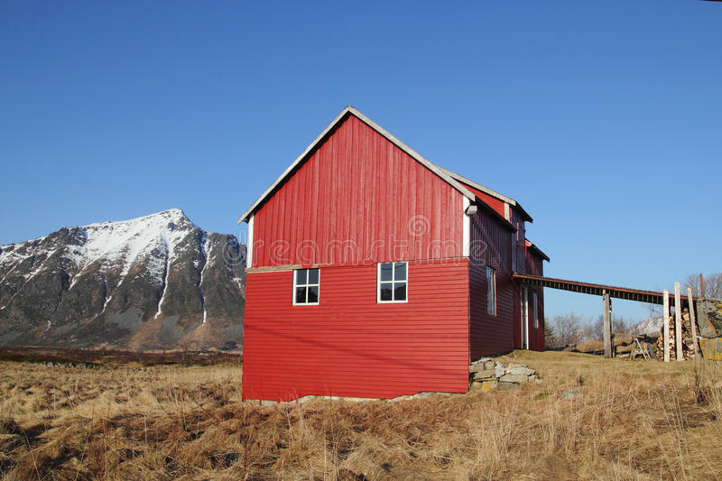Lofoten's loft, mounts blue sky. Traditional old Lofoten's loft under a blue sky stock images