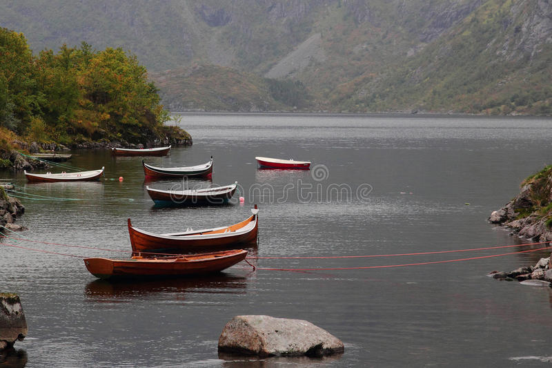 Lofoten's old boats. Traditional Lofoten's boat in a calm fjord of Moskenes island royalty free stock images