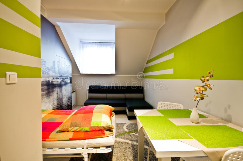 Loft bedroom with green theme stock photography
