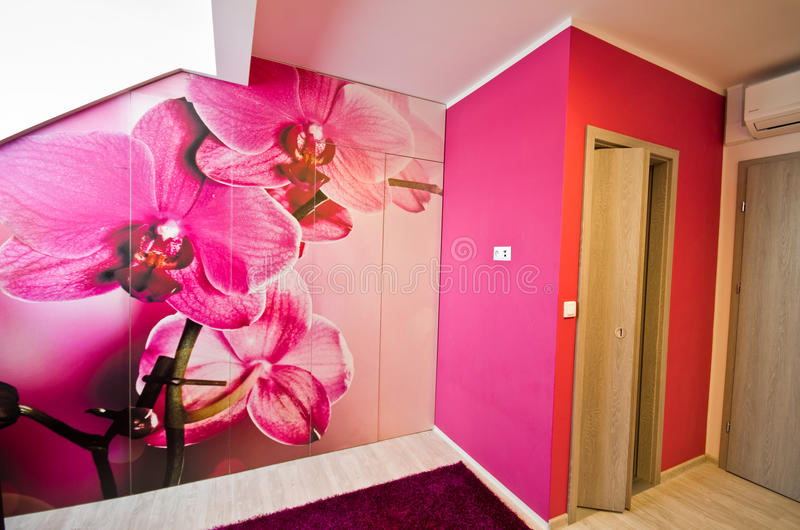 Loft conversion with orchid theme decoration royalty free stock photography