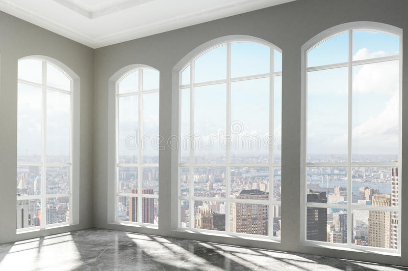 Loft interior with big windows and city view stock image