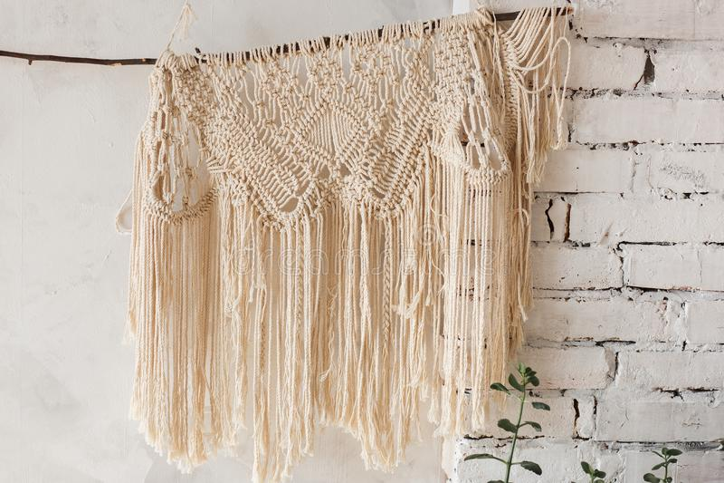 Loft interior white wall background, brick texture with knitted decor shawl.  royalty free stock images