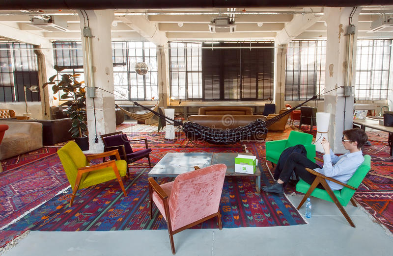Loft style hotel lobby with vintage furniture, chairs and carpets inside stock images