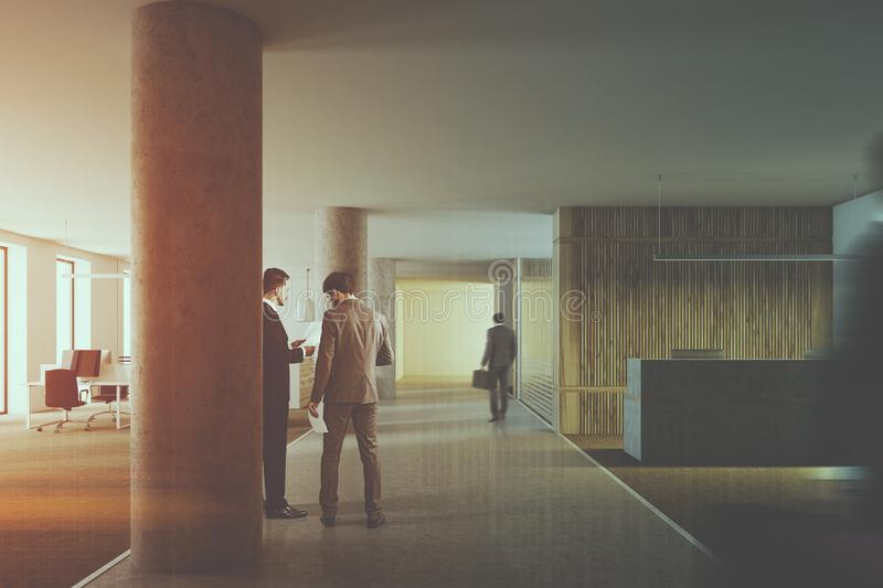 Loft wood reception hall, columns, people toned royalty free stock images
