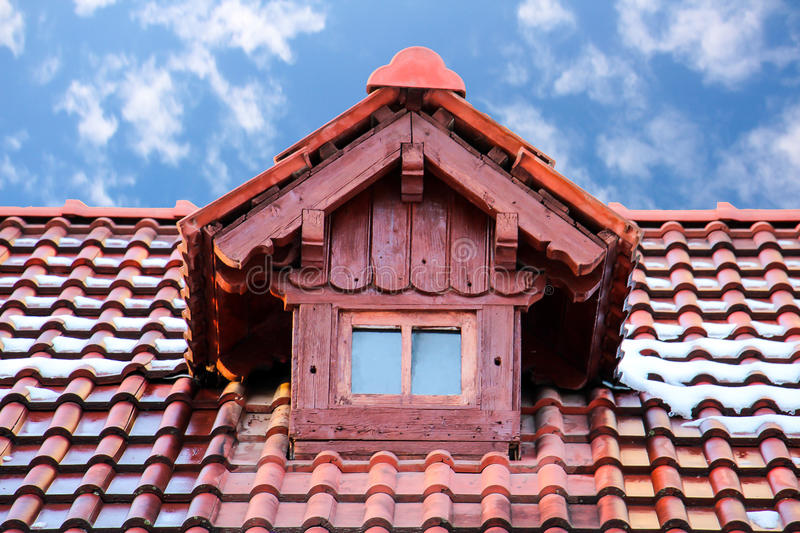 Log cabin gable and roof. A closeup view of a gable or dormer window on the roof of a small log cabin royalty free stock photos