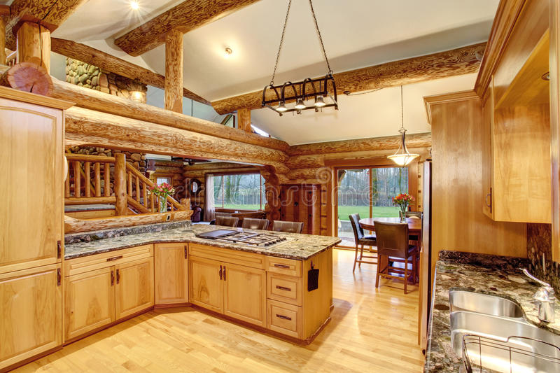 log cabin kitchen interior design with honey color cabinets stock