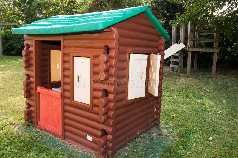 Log cabin playhouse stock photo image of pretending for Pvc playhouse kit