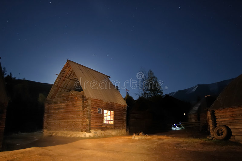 Log Cabin At Starry Night Stock Image