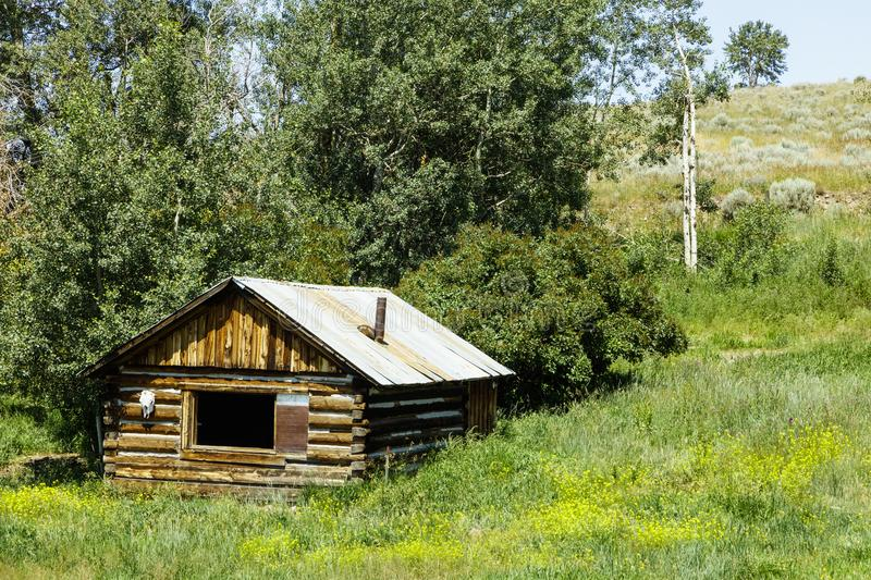 Log cabin western homestead trees royalty free stock photography
