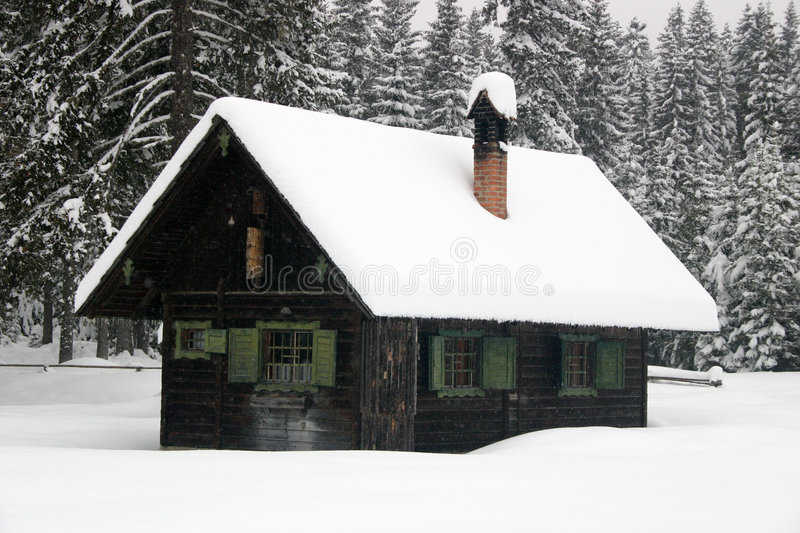 Log cabin in the winter stock photo