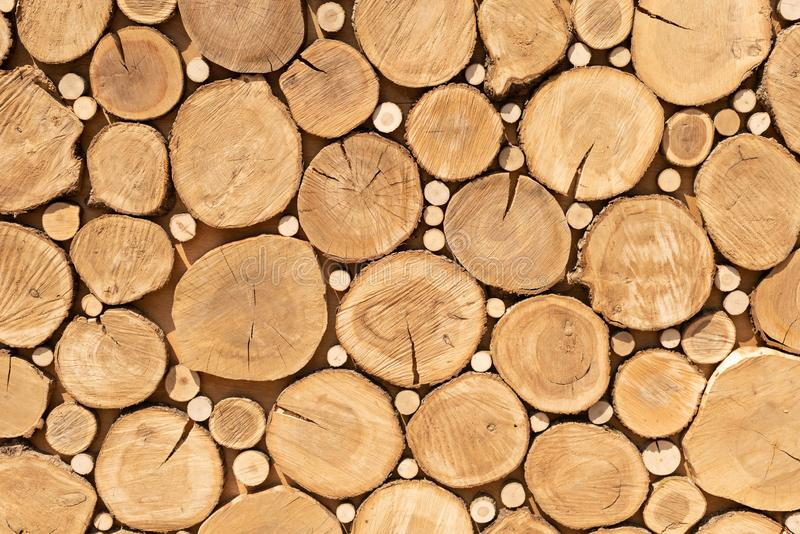 Log cuts close up. Stack of logs. close up. Logs cuts prepared for fireplace. Woodpile. Saw cuts design texture. Firewood stock photos