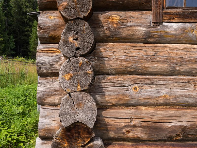 Log cuts on wooden rustic wall corner. Elements of an old rustic house made of wooden logs royalty free stock image