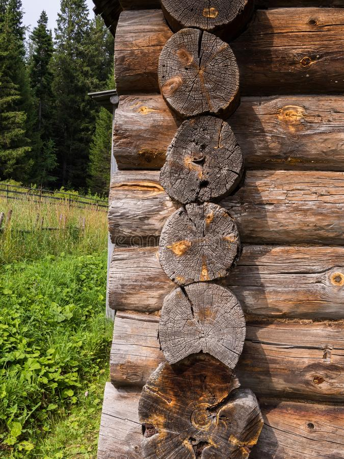 Log cuts on wooden rustic wall corner. Elements of an old rustic house made of wooden logs royalty free stock photos