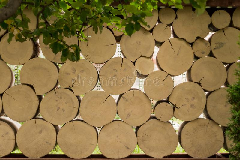 Log fence in the garden stock photography