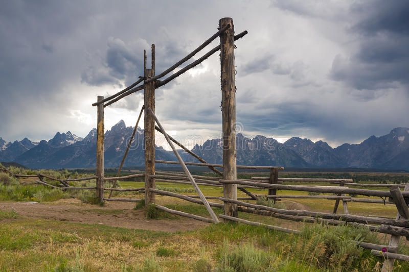 Log fence and Teton Mountains royalty free stock images