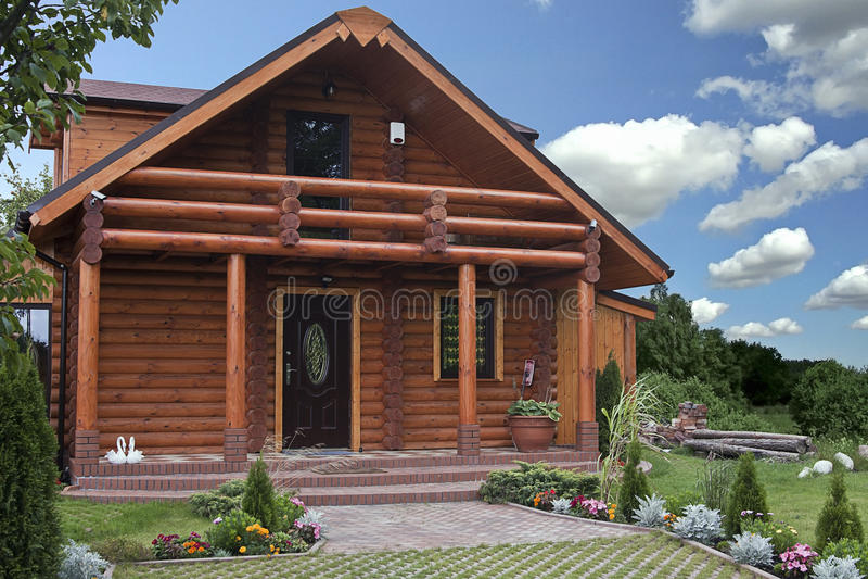 Log house. Cozy log house amongst green environment