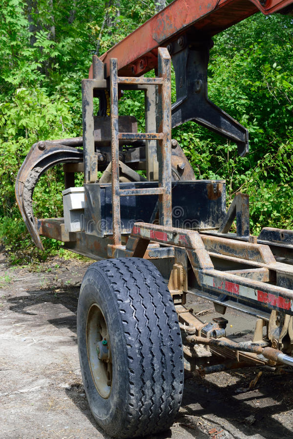 Log Loader Trailer and Grapple. Grapple for loading logs on trucks stock images