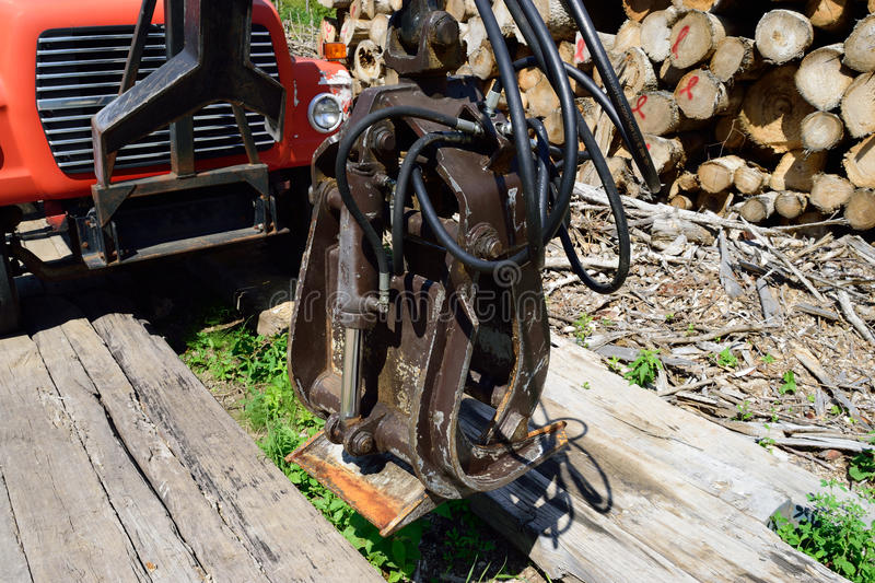 Log Loading Grapple on Old Truck. Old truck and log loading grapple stock image