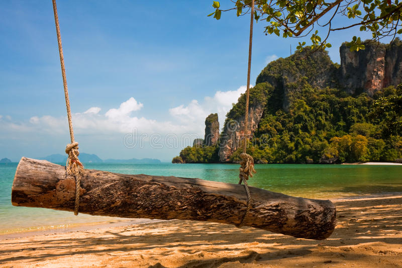 Log Swing on a Tropical Beach stock images